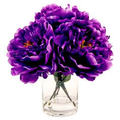 Create a lush tablescape or charming vignette with this lovely faux peony arrangement, showcasing vibrant purple blossoms nestled in a timeless glass vase.