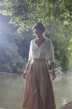 Gorgeous white blouse with camel maxi skirt. Perfect for hot summer days when you don't want to wear sunscreen!