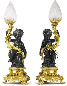A  pair of gilt and patinated bronze single-branch candelabra lamps. Paris, mid 19th century.
