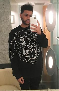 The Weeknd taking a mirror selfie in a Stenciled-Rottweiler Cotton Sweatshirt by Givenchy