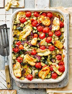Our vegetarian tray bake packs in plenty of seasonal veg and salty halloumi for a vibrant summer dinner ready in 30 minutes