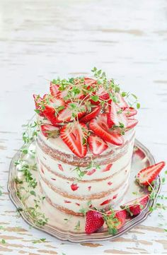 Naked Cake With Cream Cheese And a strawberry Filling and Fresh Strawberries On Top
