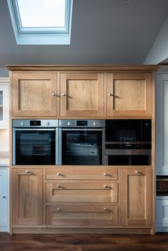 This handmade kitchen was mainly painted white with two beautiful Oak pieces. This oven & warming drawer cabinetry has large cupboards at the top for things that are more seasonally used, with deep pan drawers at the bottom for pots, pans & lids Timber Kitchen, Larder Cupboard, Integrated Fridge, Handmade Kitchens, Bespoke Kitchens, Family Kitchen, Kitchen Cabinets, Cupboards, Dinning Table