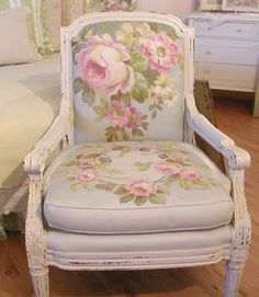 This chair has been reupholstered and hand painted by Christie Repasy