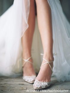 """- Anita - 'Enchanted' bridal collection - Illusion mesh upper graced with delicate Alencon lace - Cross ankle straps - Lovely tied bow at heel cups - Feminine and classic - Ivory - 3 3/4"""" inch heels - Handmade - Imported mesh and silk upper - Imported leather sole - Heavy padding for all-day comfort - Sizing runs true to size"""