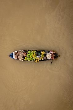 A vendor on a river Photo by Ly Thuan — National Geographic Your Shot