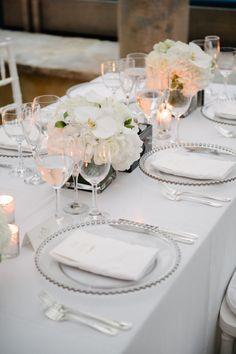Stunning all white Hamptons wedding decor: http://www.stylemepretty.com/new-york-weddings/long-island/the-hamptons/sagaponack/2017/03/17/gorgeous-hamptons-dinner-party-or-wedding-you-decide/ Photography: Brian Hatton - http://brianhattonweddings.com/