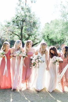Blush and rose mix and match bridesmaids with wild bouquets.  Romantic blush backyard Arizona garden wedding by Pinkerton Photography, Arizona Wedding Photographer.