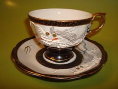 Googly eyes dragonware cup and saucer by TheDragonShoppe on Etsy, $30.00