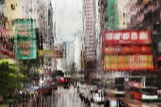 Image from website of Christophe Jacrot. From his series Hong-Kong in the rain. I love the way rain changes the colour and shape of things.