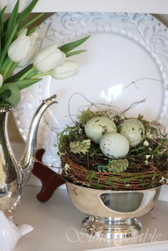 Love the combo of rustic nest with elegant silver