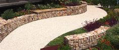 The gabion wall curves, reverse curves and also drops down along its length