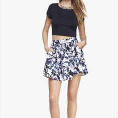NWOT Floral High Waist Full Mini Skirt Floral High Waist Full Mini Skirt from Express. Flash those stems in a flirty skirt with a vintage silhouette and a modern, graphic floral print. This one practically begs for a spin on the dance floor with a solid cropped top and heels.  High banded waist, hidden back zip. Full skirt with horizontal seam detail. On-seam hand pockets. Satiny lining, hits above the knee. I don't think I'll get back to this size again after babies, never had a chance to…
