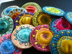 I just love these quilted brooches; the photos of other needlework is amazing...