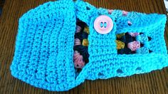 Oh So Pretty Crochet Granny Square Dog Sweater I was inspired by a photo of a puppy in a granny square coat and my husband who wanted something he could easily put on our dog Bailey. Simply slide over the dogs head and then just fasten the button around the chest area and done. Apprx size 11 long from neck to tail and would fit a waist or chest size of 13 inches Made in a non smoking home by left handed crocheter . Shipping: USPS Priority Flat Rate (arrives in 3 days )  Parcel post / regular…