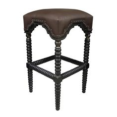 <b>Material:+Mahogany Finish:+Hand+Rubbed+Black+w/+Gold+Trim Fabric:+Brown+Antique+Leather<b>  Available+as+a+barstool+and+counter+stool.  <b><i>Noir+products+are+hand+finished+and+created+with+a+concentrated+effort+toward+environmental+sustainability.+Variations+could+occur+and+are+not+considered+as+product+defects.</b></i>