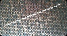 Lots of pennies covering a floor/wall grouted in black.