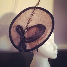 Handmade, 10 inch navy and nude sinamey disc fascinator with sinamey bow and quill feather. by caron rose millinery.
