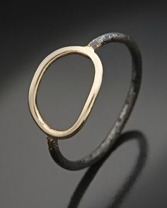 O Ring by Peg Fetter. Please note: The oxidized finish of this ring will naturally lessen with time.