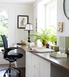 A long counter and clever storage maximize the functional beauty of this built-in workspace. The arrangement is a great way to carve out a home office/homework space in any room, and the orientation with the window offers a v