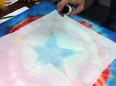 how to get a design on a tie dye shirt.. spray paint!!