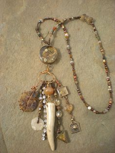 Amulet necklace with Ice Resin filled bezel, antler, ammonite,  minus the antler.