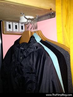 She hung a drawer pull upside down under the shelf for hangers...clever ;)
