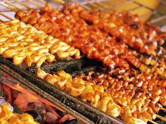 Isaw: A street food staple - grilled chicken intestines skewered on barbecue sticks. It is often dipped in vinegar infused with garlic and hot chili peppers. Perfect with an icy bottle of San Miguel Beer.