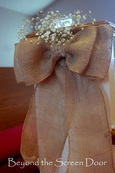 diy burlap bow with flowers for wedding decoration - beyond the screen door, wedding ornaments