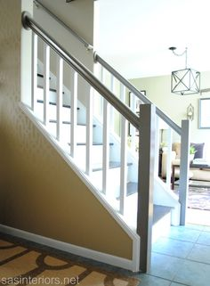 Railing and bottom post and how white is featured. Staircase Makeover Final Reveal