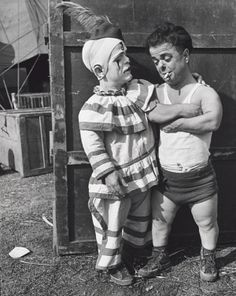 """Two Midget Clowns Backstage""(1940) - John Gutmann. He is recognized for his unique ""worm's - eye view"" camera angle."