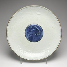Circular dish of porcelain, moulded decoration of children, and central medallion of birds in underglaze blue: Japan, late 18th century, K.2005.560