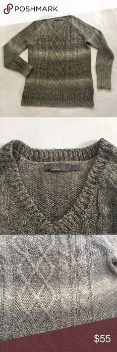 """PrAna Women's Gray Chunky Cable knit Sweater Sz L The best part of fall is the return of sweater weather. The prAna Leisel Sweater has a V-neck, relaxed boyfriend silhouette, and side slits. Multicolor sweater Knit. Cable front. 💯 acrylic. In excellent used condition. No flaws! Shoulder to shoulder-17"""", pit to pit-20"""", length of sleeve-23"""", length of sweater-26.5"""". Prana Sweaters V-Necks"""