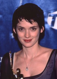 Winona with her Actress of the Year Award at the Showest Movie Event in Las Vegas, 1997