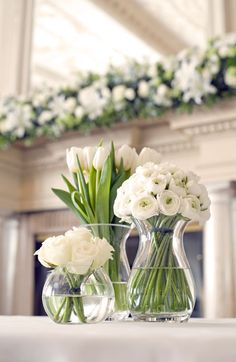 beautiful cluster of vases with grouped white flowers