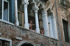 i saw these two girls while riding a gondola in venice. they were smoking and chatting on their windowsill, waving at passing boats. i thought they were incredibly lucky; i would love to share an apartment with my friend or sister in the most romantic, magical place in the world. it would be like living a dream.
