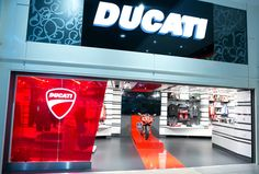 """Ducati clothing and accessory store in Mancherster Airport. """"It's a bit different for an airport but we believe it's the right audience as there's a large international contingent using Terminal 1. We've already seen that there's a lot of motorbike enthusiasts using Manchester for travel and many have unsuccessfully tried to buy the display bike already."""""""