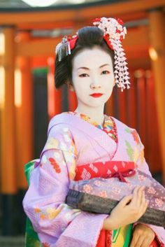 Lovely young Geisha in lavender