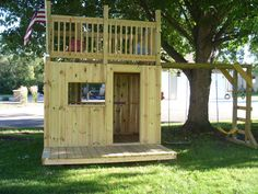 Build a clubhouse with 2 levels and monkey bars
