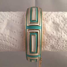 Vintage+Crown+Trifari+goldtone+metal+hinged+bracelet+with+turquoise+and+white+enamel+geometric+concentric+rectangle+design.+Tongue+and+groove+clasp+plus+safety+chain. Pre-owned+costume+jewelry.+ Some+signs+of+aging.
