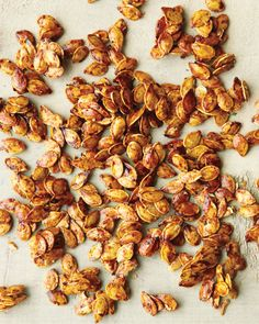 Don't toss those seeds! With a bit of seasoning and a little honey, you can make a sweet and spicy snack with a satisfying crunch. Pumpkin seeds (or pepitas) provide bone-strengthening magnesium and copper, cholesterol-lowering phytosterols, and anti-infl Fall Recipes, Holiday Recipes, Snack Recipes, Healthy Recipes, Healthy Foods, Yummy Snacks, Healthy Eating, Yummy Food, Savory Snacks