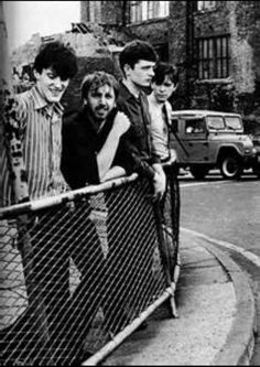 A photo of the members of Joy Division, which are Stephen Morris, Peter Hook, Ian Curtis, and Bernard Sumner. This was taken by Anton Corbijn, one of my favorite photographers!