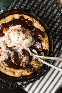 This Chocolate Chip Cookie Blondie Skillet Sundae For Two is the perfect dessert to whip up when you want something sweet but don't want to make a huge batch! A thick and chewy chocolate chip cookie baked in a mini skillet topped with ice cream and a rich chocolate sauce will cure any sweet tooth!