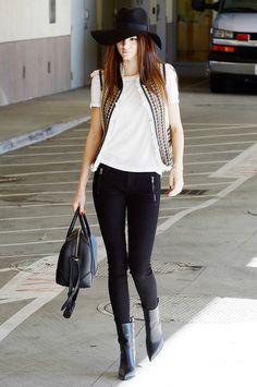 Black 'floopy' hat, white tee, black studded vest, black skinny jeans, black purse and black sleek heels