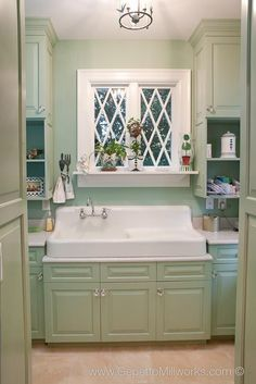 Vintage 1920's bathroom sink and cabinets renovation detail- Windows are compatible with our historic house