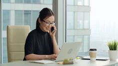 cd8d749a3d59a Asian girl with a smile talking on the phone in modern office Stock Video  Footage - VideoBlocks
