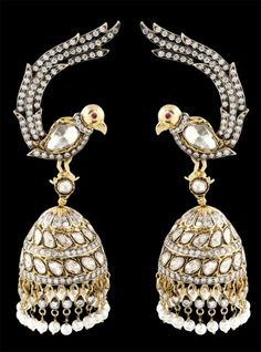 Peacock chandelier earrings by Sunita Shekhawat of Jaipur. These are an example of Thewa Jewelry: the art of fusing 23ct gold to glass