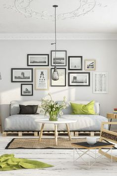 Point focal dans le salon avec les photographies  http://www.homelisty.com/idees-decoration-murale-photos/