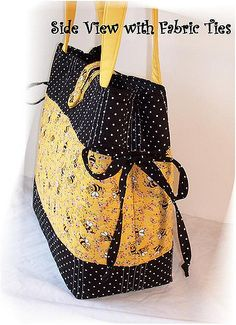 One of my favorite diaper bags.  Bumble bees on yellow background with black and white polka dots.  This bag is free-motion machine quilted.  A cute bag for the new cutie.