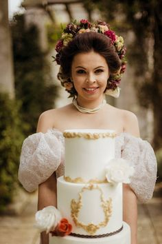 White wedding cake and elaborate flowery hair style
